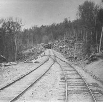Image of 74 - Train approaching diverging railway tracks.
