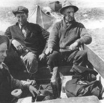 Image of 94 - New York fishing party in a motor boat towing two canoes on Lake Opeongo.