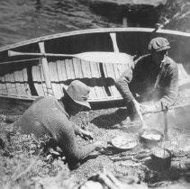 Image of 96 - George Holmberg and Park Ranger Mr. Jim Shields cooking over a fire on Lake Opeongo.
