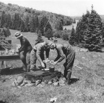 Image of 1932 - Fishing party from New York stopping for a meal on Lake Opeongo at the site of the old Dennison farm.