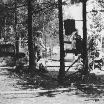 Image of 99 - George Holmberg and Mr. Shields with a fishing party from New York at campsite near Lake Opeongo.