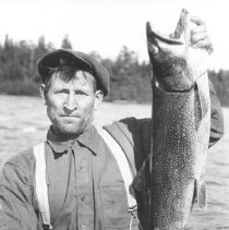 Image of 106 - Norm Bowers with a thirty-two pound Lake Trout on Lake Opeongo.
