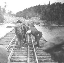 Image of 108 - Straightening the rails on the Grand Trunk Railway line Ink Lake bridge after a fire.