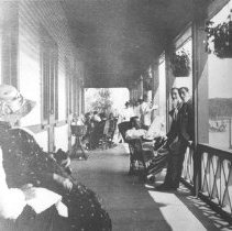 Image of 174 - Guests on east end of the long veranda at Highland Inn.