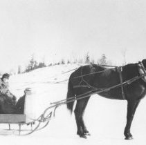 Image of 1925 or 1926 - Tom McCormick and daughter, Mary, with cutter and horse on Brule Lake.