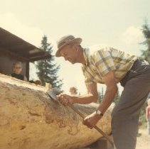 Image of 242 - Felix Luckasavitch squaring a log at the Pioneer Logging Exhibit.