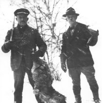 Image of 260 - Superintendent J.W. Millar, right with wolf carcass.