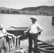 Image of 340 - Dr. and Mrs. McKay with their catch of lake trout, Opeongo Lake.