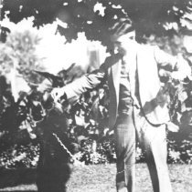Image of 1932 - Algonquin Park Station master with pet bear cub, Cache Lake.