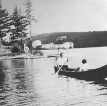 Image of 483 - MacDougall's plane and canoeists at Nominigan.