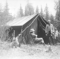 Image of 588 - Two men outside a canvas tent.