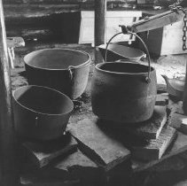 Image of 658 - The cooking utensils in the camboose shanty.