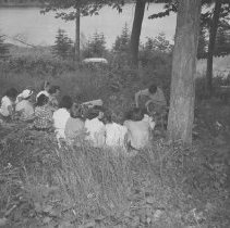 Image of A.F. Helmsely (Park Naturalist) giving a talk to a girls group