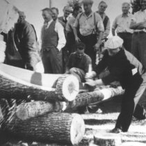 Image of 755 - Log sawing contest, Regatta Day, in front of the Highland Inn, Cache Lake.