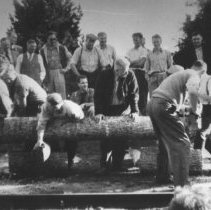 Image of Log sawing contest on Regatta Day in front of the Highland Inn.