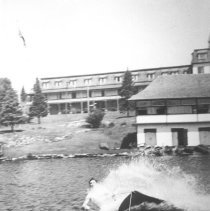 Image of 759 - Using the aqua-board at the Highland Inn, Cache Lake.