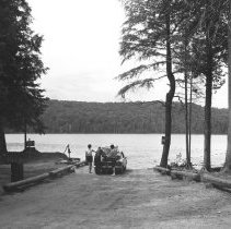 Image of July, 1963 - Unloading boat from car at water's edge Canisbay Campgrounds, July, 1963.