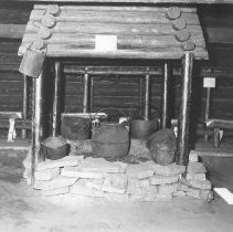 Image of 861 - Fireplace and cooking utensils at Camboose Camp, Pioneer Logging Exhibit, 1963.