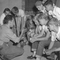 Image of 890 - J.D. Roseborough teaching nature class using a live garter snake.