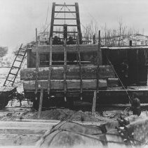 Image of 1046 - Loading freight with waney timber for shipment