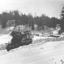 Image of 1075 - A nice load of white pine approaches Kioshkokwi Lake dump.