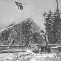 Image of 1088 - Loading logs on skidder or train, Diver, Ontario.