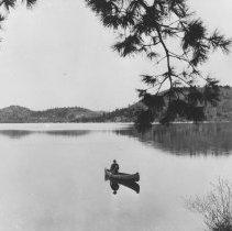 Image of 1133 - Mr. Edward Godin, Forest Ranger, in canoe, Grand Lake.