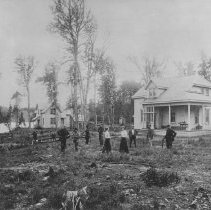 Image of ca. 1900 - The clearing at Cache Lake headquarters, circa 1900, showing Superintendent's home and some of the early Rangers.