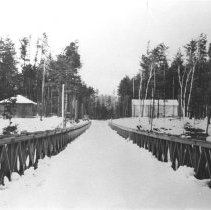 Image of 1259 - Montgomery Cabin and garage with Petawawa Bridge in foreground