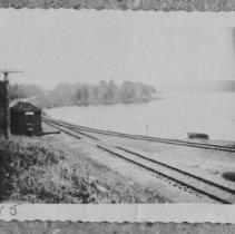 Image of 1517 - Lake Kioshkokwi at Kiosk with Ranger cabin on point.