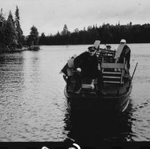 Image of 1525 - Removing furniture from Glen Donald Lodge, Source Lake, prior to destroying the building.
