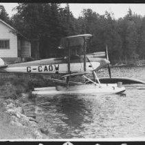 Image of between 1938 a 1939 - Tiger moth at Smoke Lake.