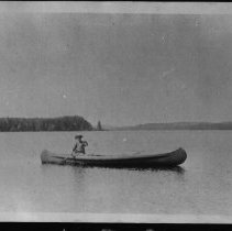 Image of 1916 - Mrs. Woollett in canoe on Whitefish Lake.