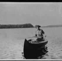 Image of 2024 - Mrs. Woollett in canoe on Whitefish Lake.