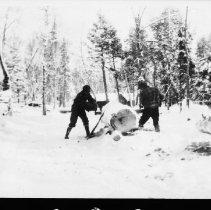 Image of 1976.27.9 - Sawing a log at a McRae Camp.