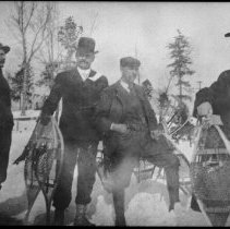 Image of between 1910 a 1920 - Taking a hike in winter.
