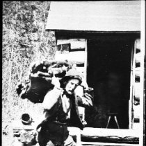 Image of 2991 - Ely Dontigney with beaver pelts.