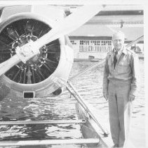 Image of George Phillips with plane at Highland Inn