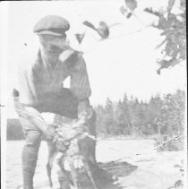 Image of 3445 - Aubrey Dunne with fawn at Smoke Lake