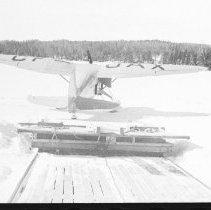 Image of 3975 - Aircraft in Front of Smoke Lake Hangar.
