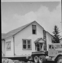 Image of 4101 - Harold Hanes' House Being Moved from Cache Lake to Clarke Lake