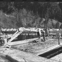 Image of 4178 - Using a Backhoe to Unload Logs from Nominigan Lodge