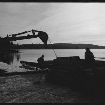 Image of 1977 - Using a Backhoe to Pile the Logs From Nominigan Lodge