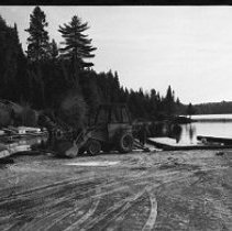 Image of 4181 - Logs From Nominigan Lodge Piled In The Parking Lot at Smoke Lake