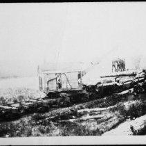 Image of 4303 - Log loader on railway flatcar
