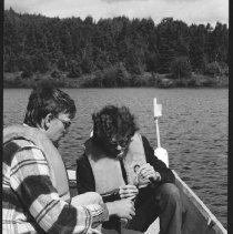Image of 4387 - Lake survey crew measuring the dissolved oxygen content at various depths, 1977.