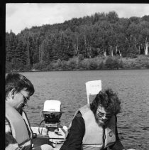 Image of 4390 - Lake survey crew measuring the dissolved oxygen content at various depths, 1977.