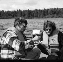 Image of 1977 - Lake survey crew measuring the dissolved oxygen content at various depths, 1977.