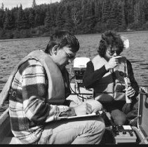 Image of 4395 - Lake survey crew measuring the dissolved oxygen content at various depths, 1977.