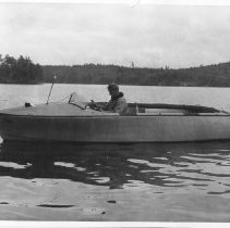 Image of 4537 - Nick Martin in fibreglass research boat, Opeongo fish lab